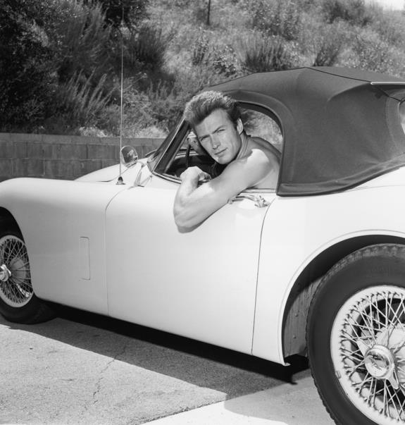 Clint Eastwood leaning out the window of a Jaguar , circa 1965