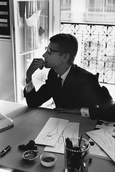 Yves Saint Laurent working at his desk