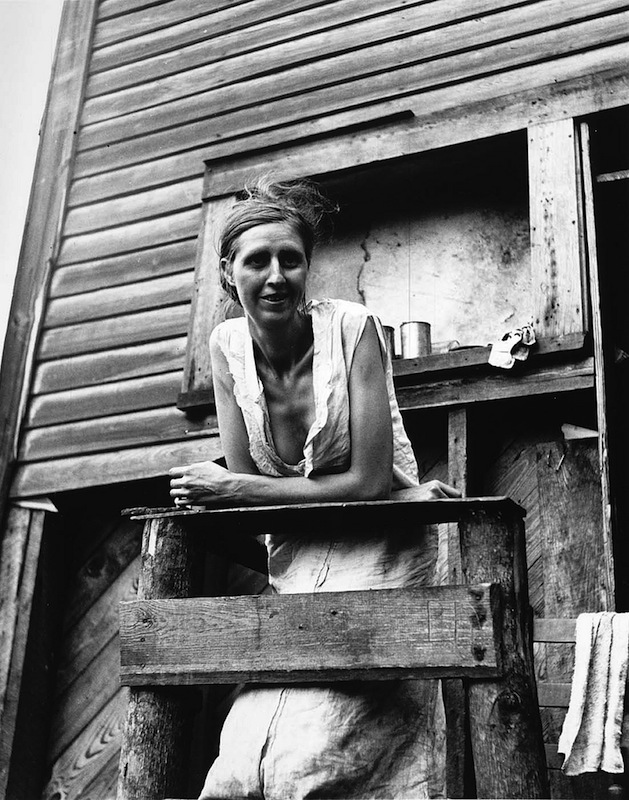 Marion Post Wolcott 01-Miner's wife on porch of their home, an abandoned company store. Pursglove, West Virginia, 1938