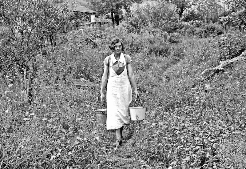 Marion Post Wolcott 03-Coal miner's wife carrying home water from the hill, Bertha Hill, West Virginia, 1938