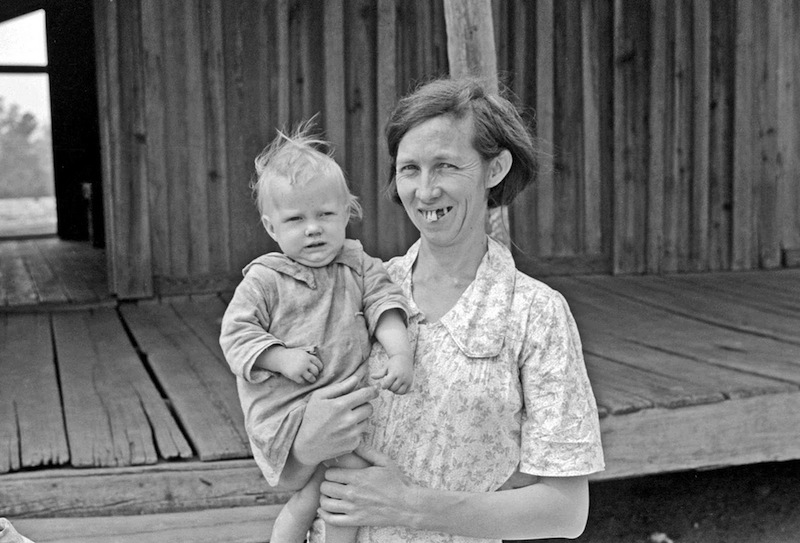 Marion Post Wolcott 05-Mrs. Ellis Adkins and her youngest child. The family are rehabilitation borrowers, Coffee County, Alabama, 1938