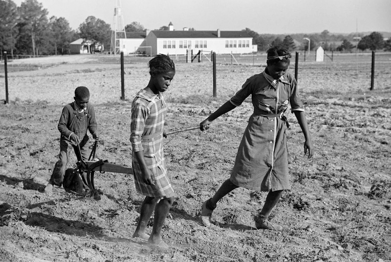 Marion Post Wolcott 10-Behind the homemade plow in the school garden, Gees Bend, Alabama, 1939