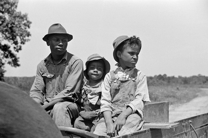 Marion Post Wolcott 12-Project family in new wagon, Flint River Farms, Georgia, 1939