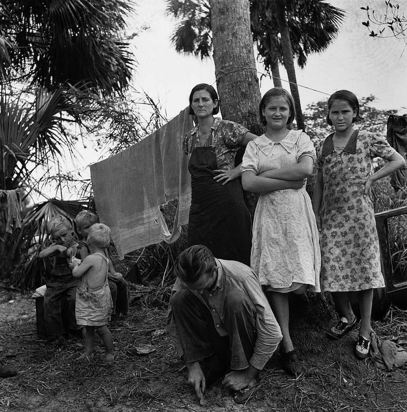 Marion Post Wolcott 16-Migrant family from Missouri camping out in cane brush. One woman said, 'We ain't never lived like hogs before, but we sure does now'. Canal Point, Florida, 1939