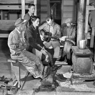Marion Post Wolcott 19-Construction workers gathered around the bunkhouse stove, Camp Blanding, Florida, 1940