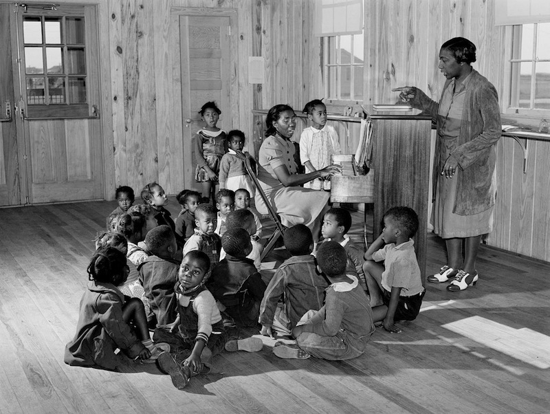 Marion Post Wolcott 21-Singing and music for agricultural workers' children in new day nursery at Okeechobee migratory labor camp. Belle Glade, Florida, 1941