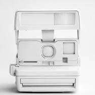 Spray-painted white Polaroid 636 Close-up