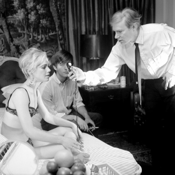 Andy Warhol checks the lighting on underground movie star Edie Sedgwick, during filming of Beauty #2, with Gino Piserchio, New York City 1965