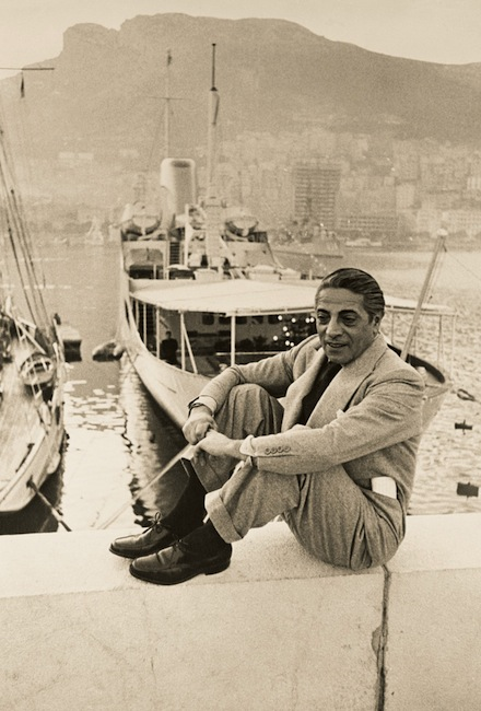 Aristotle Onassis sitting on dockside of the port in the bay of Monte Carlo, best know as Monaco