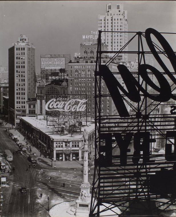Berenice Abbott-Changing New York (1935-1938)-Columbus Circle, Manhattan, Looking Northwest from above the circle, statue of Columbus, B&O bus station topped with Coca-Cola sign, other signs, Central Park with snow, February 10, 1938