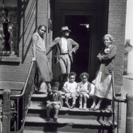 Berenice Abbott-Changing New York (1935-1938)-Jay Street, No. 115, Brooklyn, Three generations of African Americans on stoop of brick home with iron rails on steps, May 22, 1936