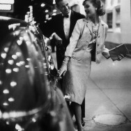Gentleman and a lady wearing a Chanel evening suit, 1958