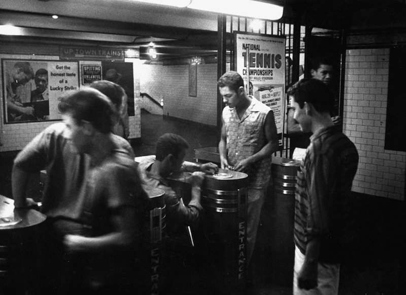Stan Wayman - Teenagers trying to work the subway turnstiles with slugs instead of tokens. New York, 1958