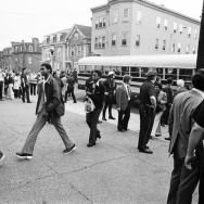 Black students arrive by bus at South Boston High School under police protection on the first day of school by Arthur Grace, 1974