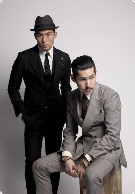 Graphic designer Huaizu -Kevin- Wang and fashion designer Hvrminn wearing Hvrminn suits, photo by Sin Yeong Chung