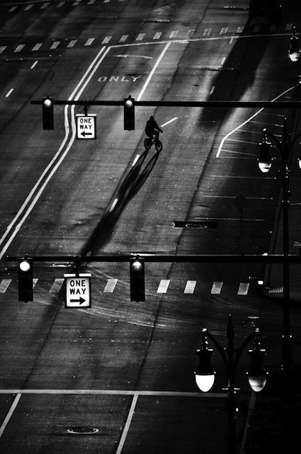 Man on a bike, crossing a street