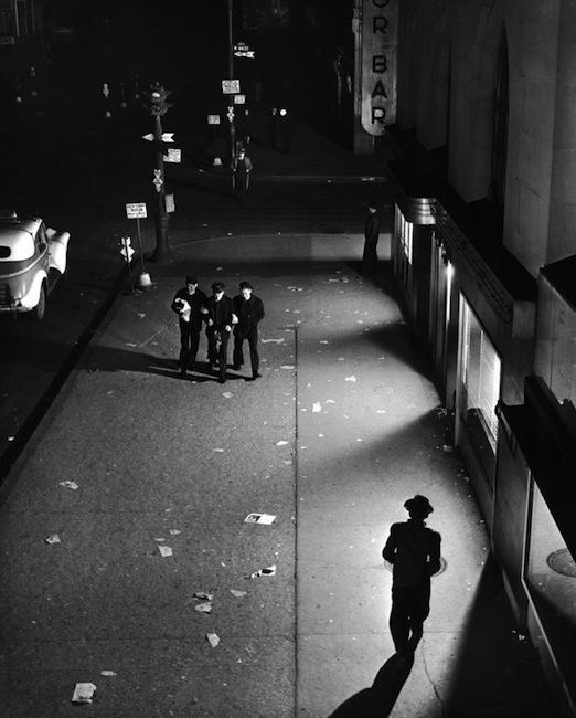 Herbert Gehr - A trio of sailors walk down a street near Times Square, NYC 1945