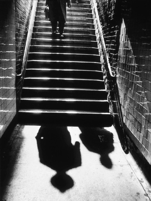 Benn Mitchell - A man and shadows in a subway stairway