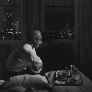 Nat Farbman - A traveling businessman watches TV in a hotel room, 1958