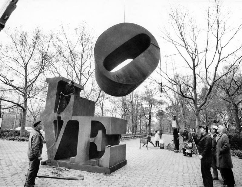 The O of the famous -Love- sculpture, by Robert Indiana, lowered into place at Fifth Avenue and 60th Street. New York, 1971 by Don Hogan Charles