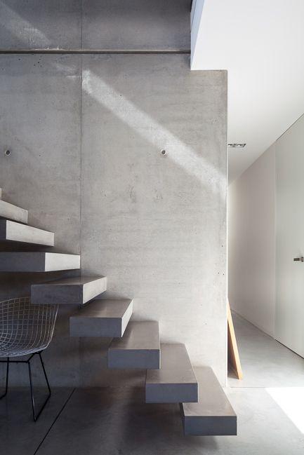 Concrete stairway in a contemporary interior
