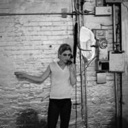 Stephen Shore - Edie Sedgwick using the only phone in the Factory
