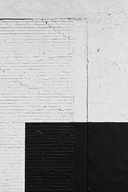 Painted white wall with a black part
