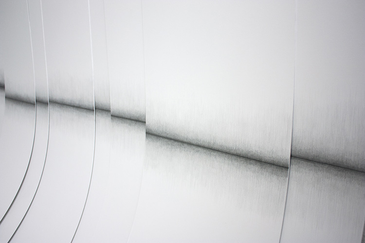 Curved folds interspersed with a blurry line