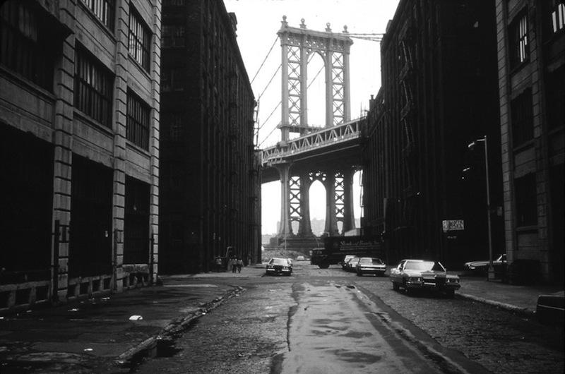 Manhattan Bridge tower in Brooklyn, New York City, framed through nearby buildings (June, 1974)