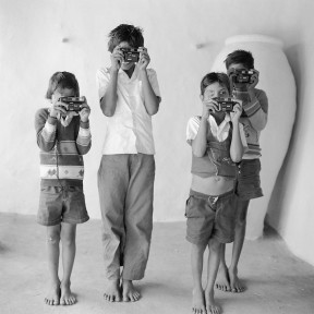 Wendy Ewald - Harshad, Hasmukh, Chandrakant and Dasrath learning to hold the camera, 1992