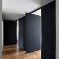Black wooden swivel door