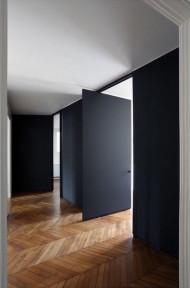 Black wooden swivel door